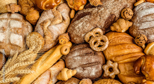 Foto Murales Fresh fragrant bread on the table. Food concept