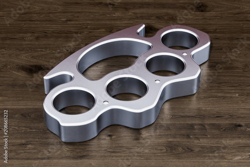 Leinwanddruck Bild Brass knuckles on the wooden table, 3D rendering
