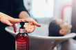 Leinwanddruck Bild - Hairdresser washes customer hair with shampoo