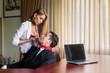 Leinwanddruck Bild - Woman strangle male at office