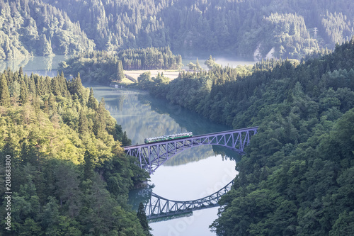 Fotobehang Spoorlijn Fukushima, JAPAN - June 17 : The local train Tadami line and Tadami river on June 17 , 2017 in Fukushima , Japan. This train services in East Japan railway company's Tadami line.