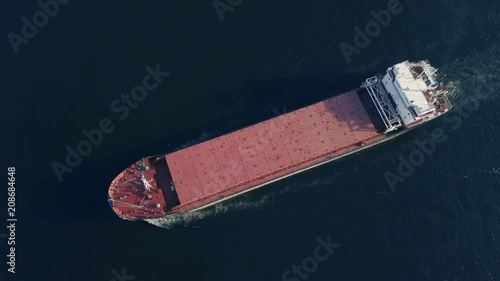 Top view of floating cargo ship