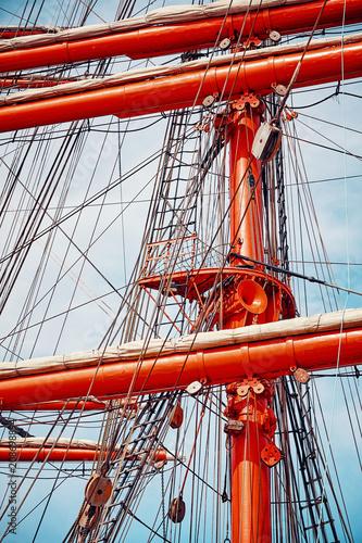 Fotobehang Schip Old sailing ship mast details, color toned picture.