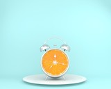 Tropical fruit concepts made of orange slice alarm clock with dish on blue pastel background. minimal business concept. Idea creative to produce work within an advertising marketing communications - 208705212