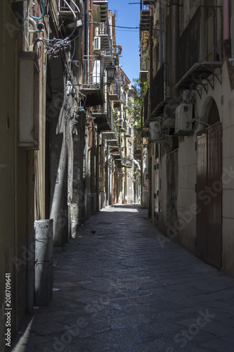 Fotobehang Smalle straatjes Narrow street in city of Palermo, Sicily, Italy