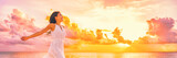 Fototapety Well being free woman with open arms in the air blissful happiness concept banner. Happy woman against pink pastel colorful sunset sky.