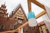 White-blue lamp hanging in front of the Town Hall of Wroclaw