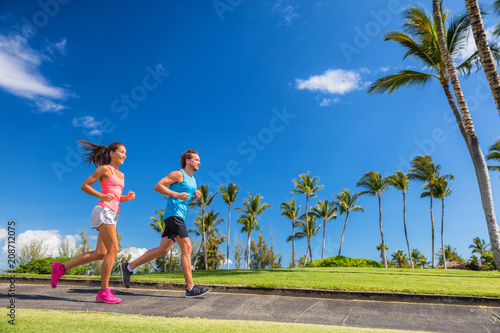 Fotobehang Hardlopen Fitness athletes weight loss workout. Getting in shape for the summer.