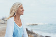 Leinwanddruck Bild - Attractive middle-aged blond woman at the seaside