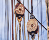 Vintage toned old sailing ship wooden pulleys, nautical background. - 208718461