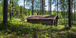 Leinwanddruck Bild - Old and idyllic abandoned timber cottage at summer day in Finland