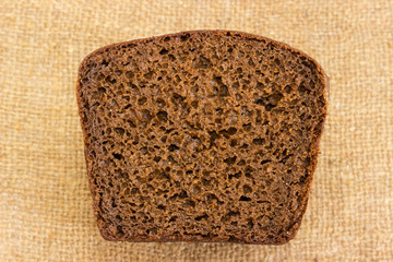 View of cut of brown rye and wheat bread on sackcloth