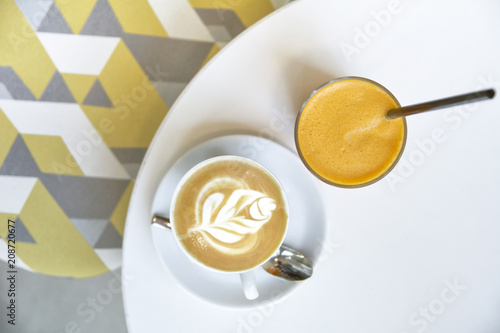 Wall mural Coffee Cappucino and Orange Juice on white table