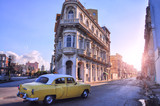 Fototapety Street with old buildings and a retro car. Havana. Cuba.