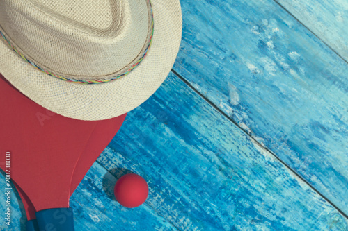 Fototapeta Equipment for playing beach tennis on the blue wooden background