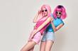 Two Girls Having Fun Dance. Pink Fashion Hairstyle