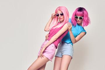 Two Girls Having Fun Dance. Pink Fashion Hairstyle © evgenij918