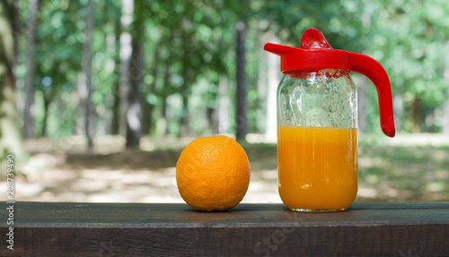 Fotobehang Sap Fresh orange juice on wooden table. Nature background with copy space.