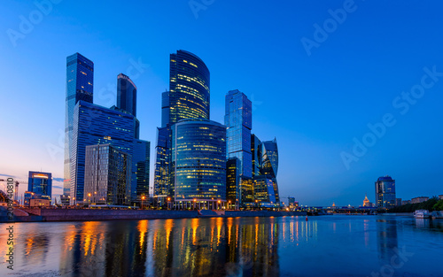 Fotobehang Moskou Skyscrapers of Moscow City business center and Moscow river in Moscow at night, Russia
