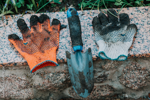Foto Murales On the granite slab lies a garden savage and working gloves