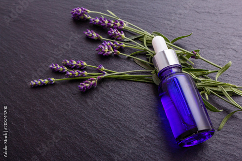 Lavender essential oil in a glass bottle with a pipette - 208744200