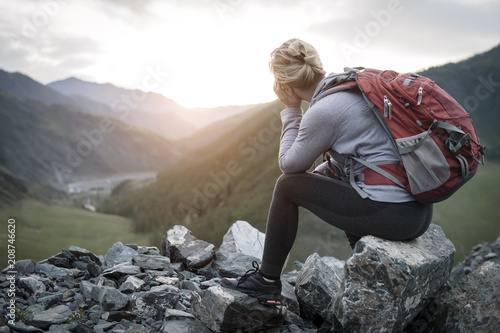 Successful adult  woman hiker enjoy the view on cliff edge top of mountain. - 208746620