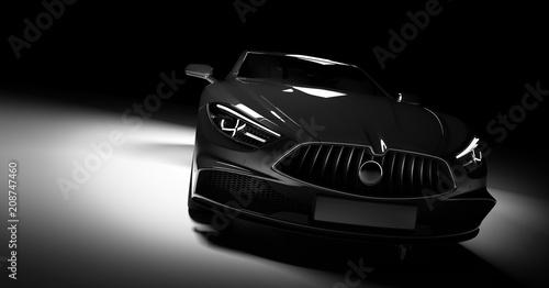 Modern black sports car in a spotlight on a black background.