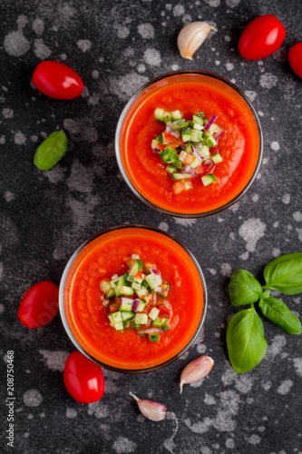 Leinwanddruck Bild Italian red tomato cold gazpacho soup in glass, with cucumber, onion, Basil