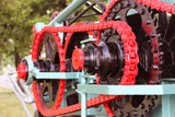 Power unit with wheels, flywheels and chain. Agricultural mechanism for harvest processing. Heavy engineering. Metal construction. Relief of manual labor. History of mechanization technologies.