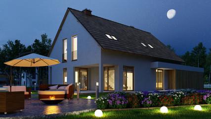 Einfamilienhaus mit Licht im Garten nachts