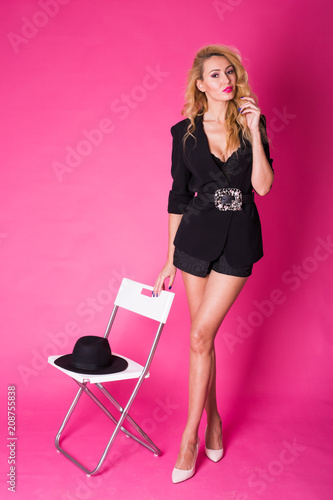 fashion studio portrait of beautiful sensual woman with blond hair with evening makeup.