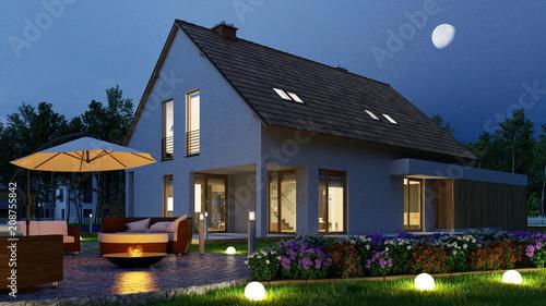 canvas print picture Einfamilienhaus mit Licht im Garten nachts