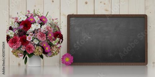 Bukiet obok blackboard dla gratulacje