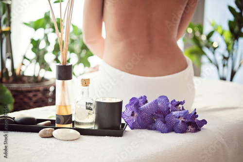 Fotobehang Spa Spa treatment, aromatherapy, a girl wrapped in a white towel after a spa treatment, scenery organic cosmetics, spa salon