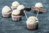 creamy cupcakes with mustache sign and Happy fathers day inscription on concrete surface - 208763643