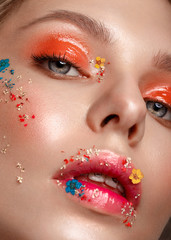 Beautiful girl with art make-up and flowers. beauty face. Photos shot in studio © bykobrinphoto