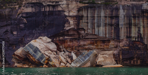 Foto Murales Pictured rocks national park on the Lake Superior, USA. Colorful textured rocks background