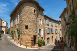 Street view with stone houses in the center of the village of Chateauneuf-du-Pape, blue sky and sunny day. Located in the Vaucluse department, Provence-Alpes-Côte d'Azur region in southeastern France