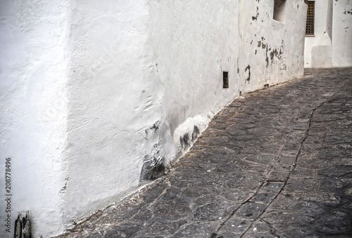 Solitary street, winter day in historic center of Ibiza. Balearic islands,Spain.
