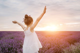 Happy cute little girl in lavender field at the sunset. Freedom Concept. - 208778687
