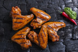 chicken wing grilled fried black background of charcoal. Barbecue grill - 208780892
