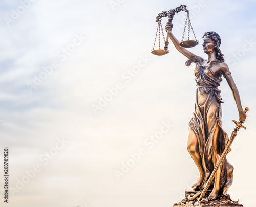 Naklejka Legal law concept image - Scales of Justice and sky background