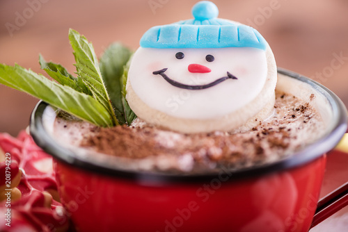 Wall mural christmas concept snowman cookie in hot cocoa chocolate red mug