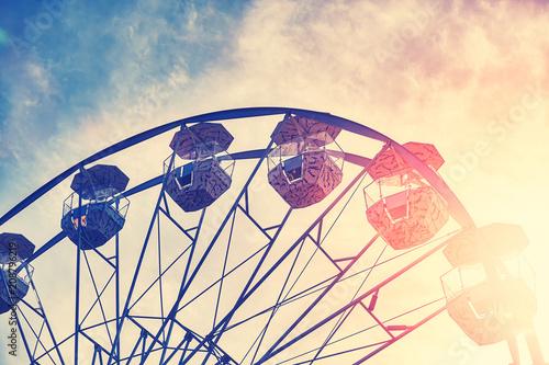 Fotobehang Amusementspark Vintage toned picture of a Ferris wheel at sunset.