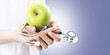 hands with Apple and stethoscope, healthy eating concept - 208801800