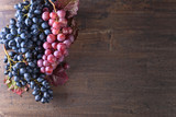 Grapes bunch with leaves. - 208804248