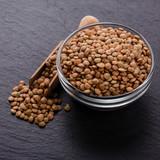 raw lentils on a dark stone background - 208804685