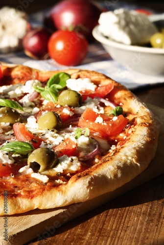 Homemade Greek Style Pizza / with tomatoes, red onions, feta cheese, olives, garlic and basil leaves - 208808881