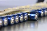 AAA alkaline batteries in perspective on metal background - 208810263