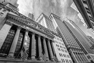Exterior of New york Stock Exchange, largest stock exchange in world by market capitalization. Wall street, lower Manhattan, New York City, USA. Black and white image.